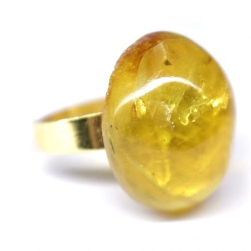 Zelta krāsas gredzens ar dzeltenas krāsas ovālas formas dzintaru